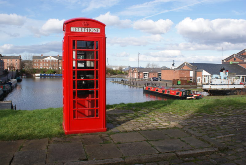 Picture of a canal basin with a red telephone box predominent in the foreground.
